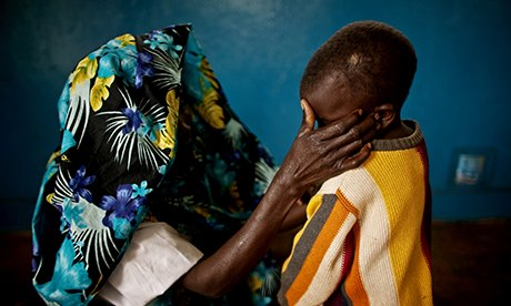 MDG : A mass rape victim and her son in the town of Fizi, Democratic Republic of Congo